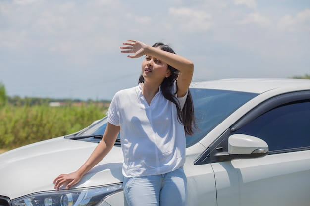 Asian girl standing at the car on the street
