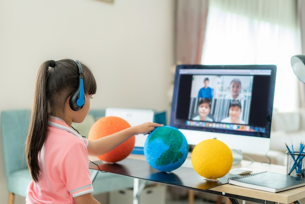 Asian girl student live learning video conference with teacher and other classmates