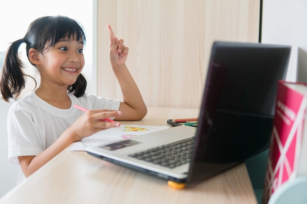 Asian girl student online learning class study online with laptop at home.