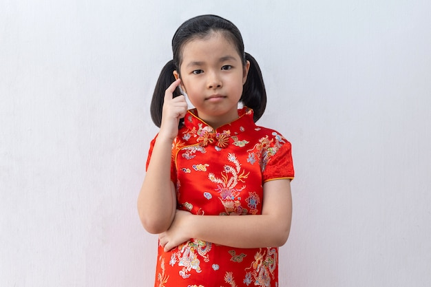 Asian girl wear cheongsam thinking