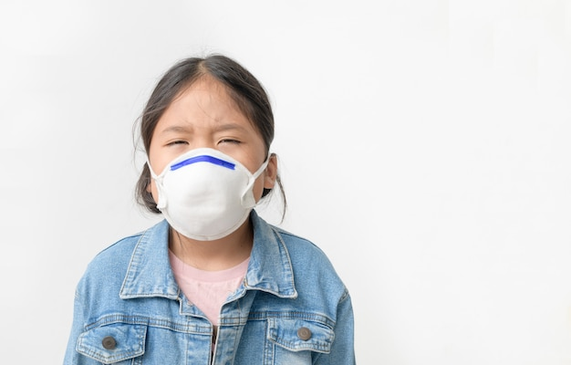Asian  girl wear n95 mask to protect pm 2.5 dust and air pollution