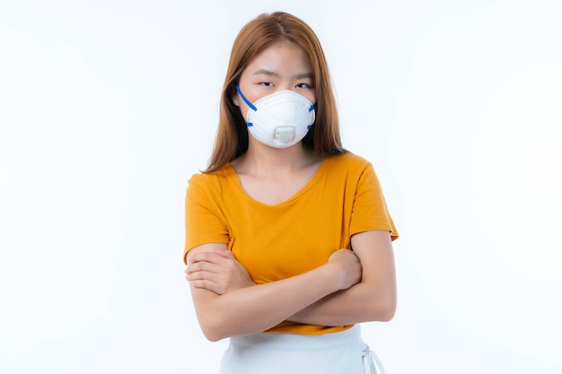 Asian girl wearing protective face mask for protection during the quarantine coronavirus covid19 outbreak on white background , protect spread covid-19