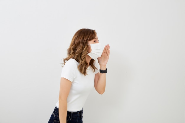 Asian girl wearing protective mask shouting
