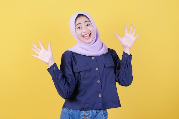 The asian girl who was very happy by wearing the hijab with incredible surprise