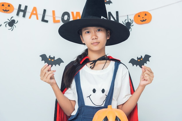 Asian girl witch costume playing in the room happy halloween