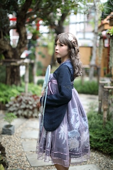 Asian girl with lolita fashion dress in garden background