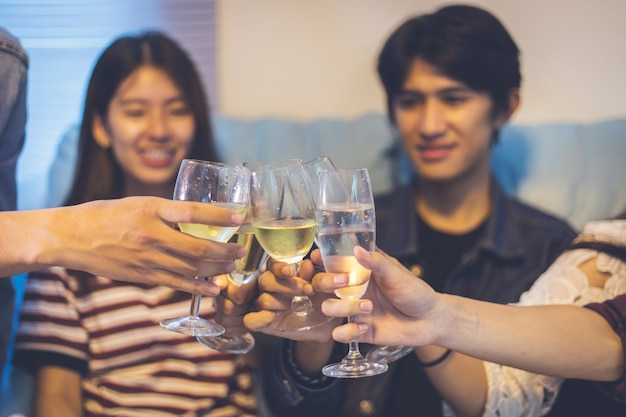 Asian group of friends having party with alcoholic beer drinks