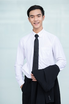Asian handsome business man in white shirt smiling