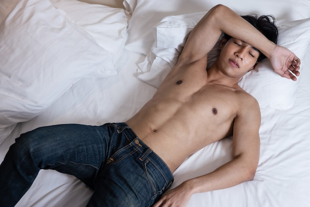Asian handsome man shirtless in room
