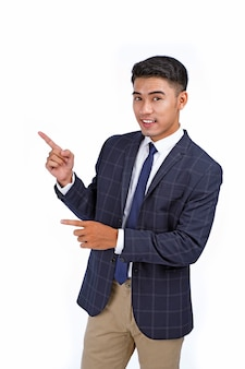 Asian handsome young business man pointing finger