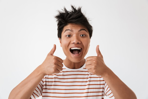 Asian happy man showing thumbs up with smile, isolated
