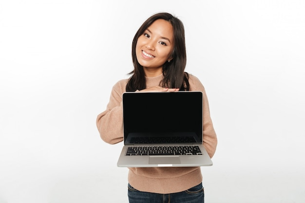 Asian happy woman showing display of laptop