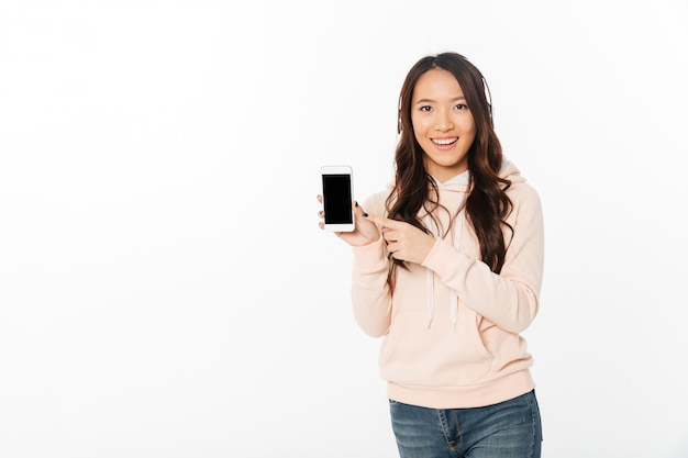 Asian happy woman showing display of mobile phone.