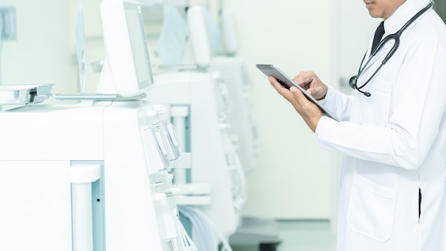 Asian healthcare and medicine. doctor using a digital tablet, medical equipment concept.