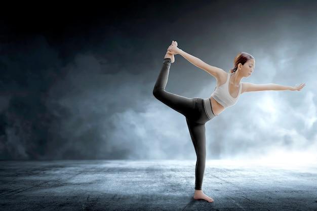Asian healthy woman practicing yoga on indoor