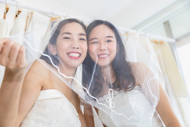 Asian homosexual couple smiling in bride dress.concept lgbt lesbian.