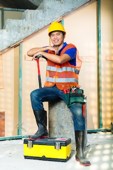 Asian indonesian construction worker on building site