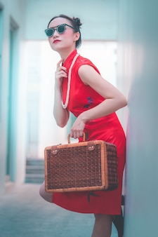 Asian japanese chinese girl with wooden luggage vintage asian travel concept