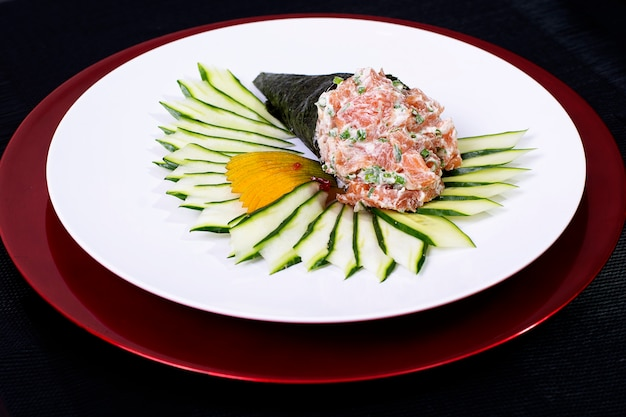 Asian japanese food sushi roll temaki with fresh fish and veggies