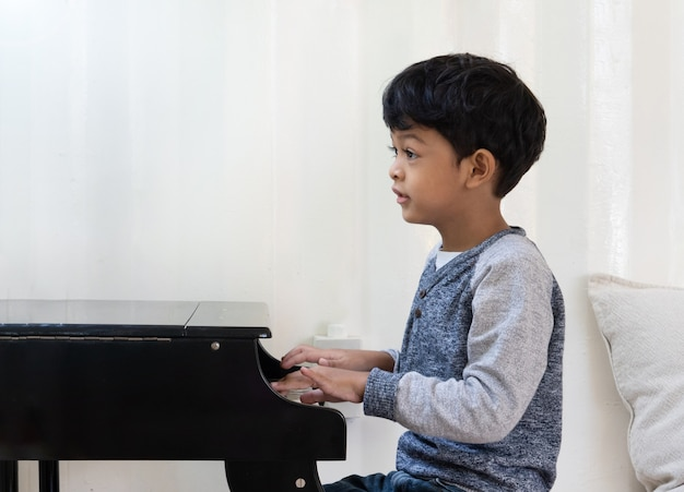 Asian japanese kid playing piano