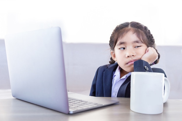 Asian kid boring learning online in digital class from home