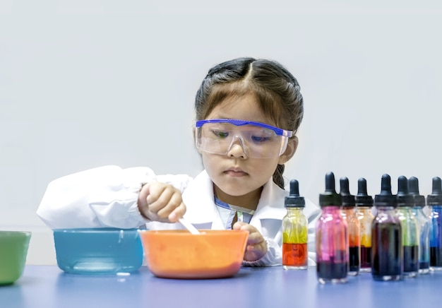 Asian kid learn chemical lab