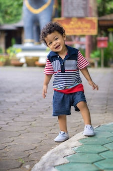 Asian kid with curly hair