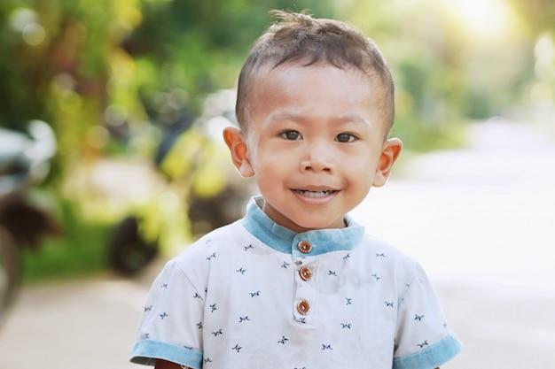 Asian kids standing smiling in morning light