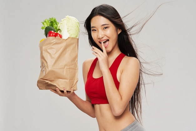 Asian lady holding a paper bag