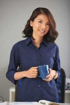 Asian lady posing with mug