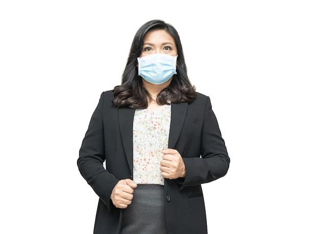 安全感染を保護するためにオフィスで新しい通常のマスクを身に着けているアジアの女性covid19コロナウイルス