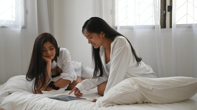 Asian lesbian lgbt couple using tablet and spending time together