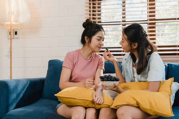 Asian lesbian lgbtq women couple eat healthy food at home