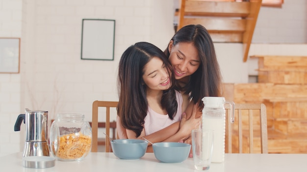 Asian lesbian lgbtq women couple have breakfast at home