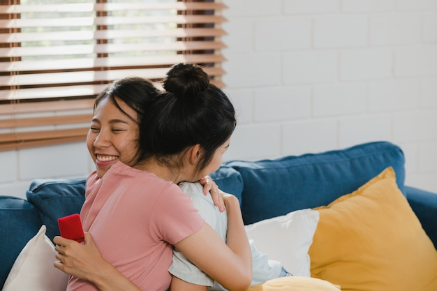 Asian lesbian lgbtq women couple propose at home