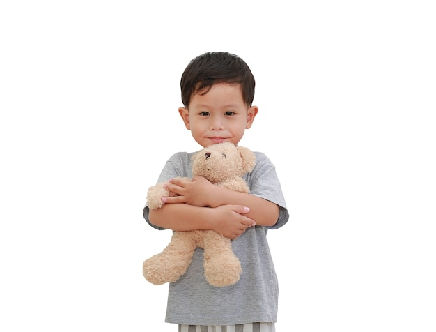 Asian little baby boy hugging teddy bear doll isolated
