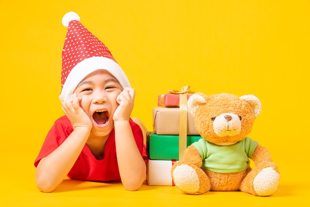 Asian little boy smile with dressed in red santa the concept of christmas day