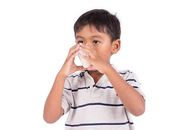 Asian little boy using an asthma inhaler