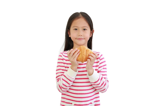 Asian little child girl holding croissant isolated on white background