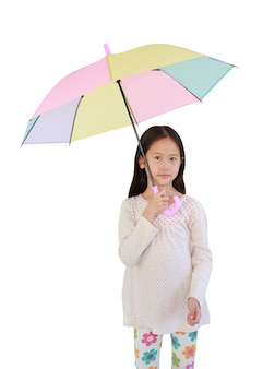 Asian little child girl with multicolored umbrella on white