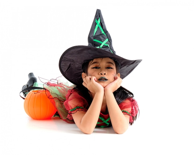 Asian little girl in costume of witch isolated on white background