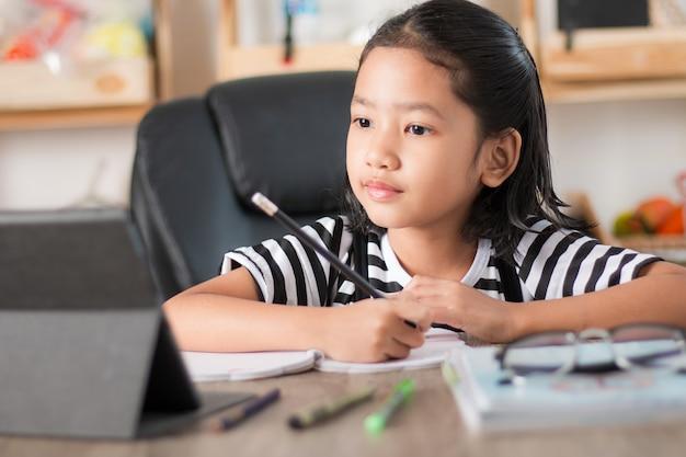 Asian little girl doing homework