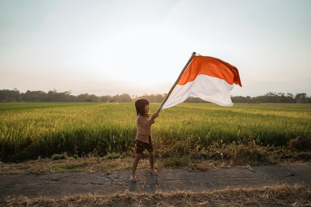 Asian little girl flapping indonesian flag