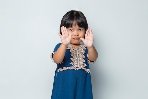 Asian little girl making stop gesture with her hand