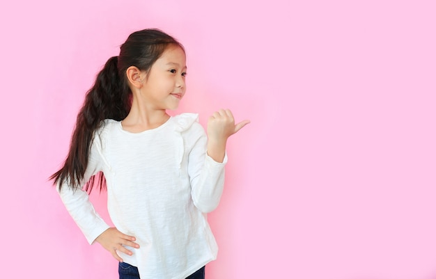 Asian little girl on pink background
