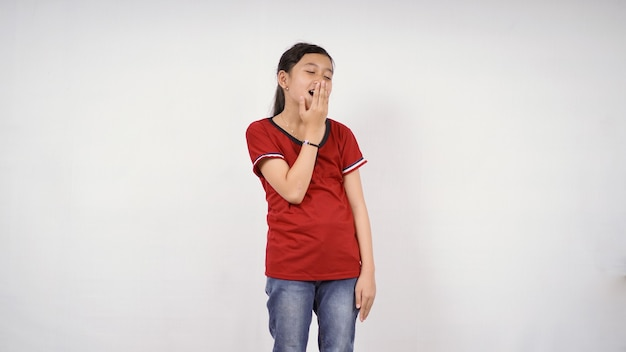 Asian little girl put her hand close her mouth isolated white background