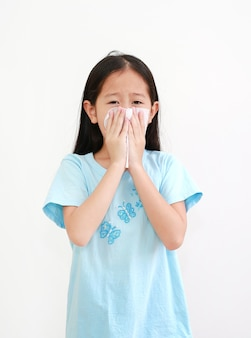 Asian little girl sick and sneeze with tissue paper isolated on white background