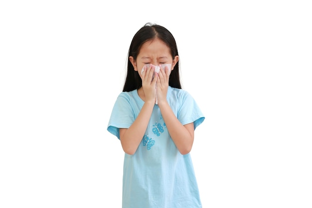 Asian little girl sick and sneeze with tissue paper