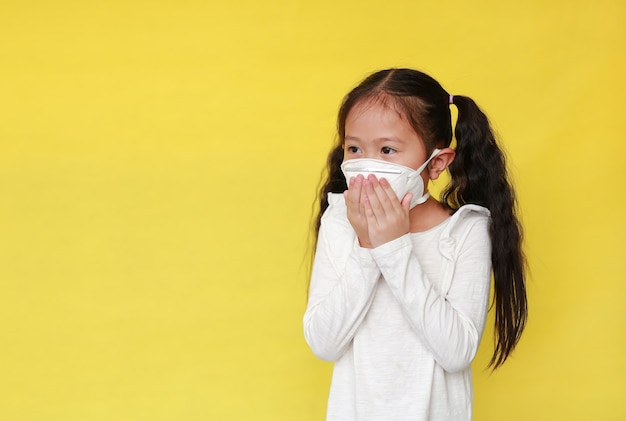Asian little girl wearing a protective mask