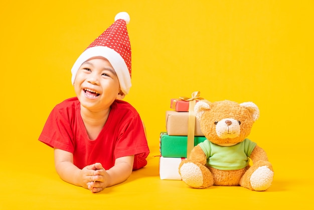 Asian little kid dressed in red santa claus hat the concept of holiday christmas day